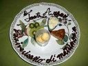 イタリア語で祝辞が書かれたデザート